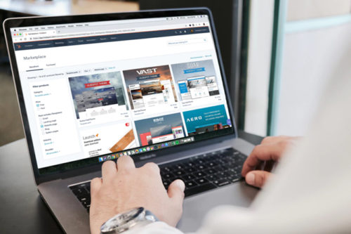 Blog image with laptop computer and hands typing